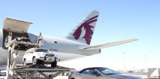 Qatar Airways Cargo unload a sportscar in Doha, Qatar